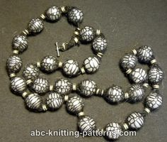 Yes, this is a knitting project! Knitting encases pearl beads.