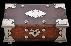 Amboyna Wood Betel Box with Silver Mounts Batavia, Dutch East Indies first half of the 18th century width: 19.2cm, depth: 13.2cm, height: 7.6cm This fine Dutch colonial betel or sirih box is from eighteenth century Batavia in the Dutch East Indies, and is composed of bevelled amboyna burlwood with silver mounts.