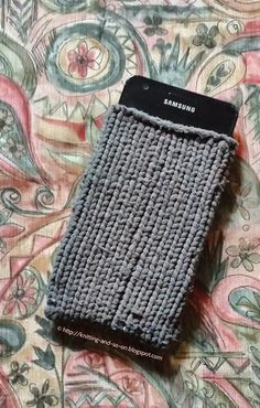 Recycling idea: Yarn from pantyhose made into a phone sock.