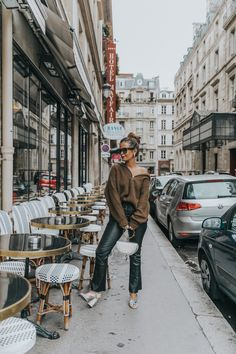 Paris Fashion Week Looks | Collage Vintage. Brown sweater+black leather pants+snake print ankle strap peep-toed embellished heels+white handbag+gold earrings+sunglasses. Fall Dressy Casual Outfit 2017 #anklestrapsheels2017