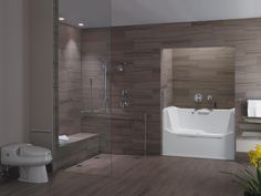 Rising Bathroom Wall. Soaking tub with side wall that rises or lowers so people can step in easily. Nice.