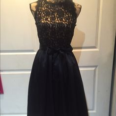 Very classy banana republic black lace&satin dress Worn a few times- stunning on- mid calf length, full skirt with fabric to support underneath, satin tie belt can be worn bow in front or bow in back. disclaimer: all items listed in my closet are used and as such may have imperfections Banana Republic Dresses