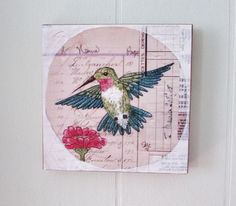 "Hummingbird Art Print Mounted on Wood Ruby Throated Hummingbird Tiny House Wall Art. ""Hummingbird and Aster"" This is a print of a original pen and ink and watercolor of mine. This is printed on a high quality matte paper using archival quality inks on an Epson printer. I then mount the print onto a 5""x5"" square of a furniture grade 3/4"" plywood. It as a hole drilled in back for hanging and is signed on the back. It is also sprayed with a protective finish. This will be shipped in a sturdy..."