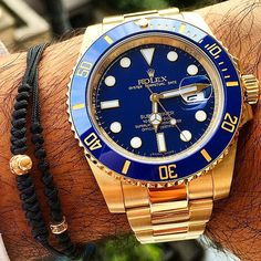 Yellow Gold Rolex Submariner watch .