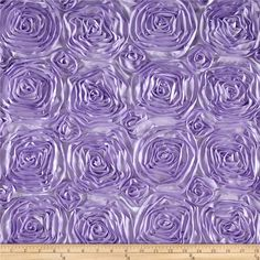 Wedding Rosette Satin Lavender from @fabricdotcom  This fabulous fabric features elegant satin ribbon sewn to lightweight satin fabric, forming intricate rosettes throughout. Each rosette measures approximately 4.5'' wide. Both selvedges feature satin 3'' wide vertical borders. Voluminous and dimensional, this fabric is perfect for home décor accents use for tabletop or create duvet covers and pillow covers, as well as special occasion apparel dresses and skirts.