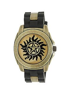 """<div>Protect yourself from demon possession with this watch from <i>Supernatural</i>. The black rubber and gold tone watch features an anti-possession symbol on the watch face.</div><div><ul><li style=""""list-style-position: inside !important; list-style-type: disc !important"""">Alloy & rubber</li><li style=""""list-style-position: inside !important; list-style-type: disc !important"""">Imported</li></ul></div>"""