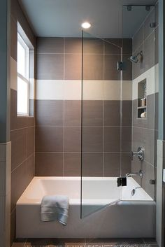 small bathtubs with shower towel window glass door wall storage ceiling light contemporary bathroom of Fabulously Cute Small Bathtubs with Shower for a Small Bathroom