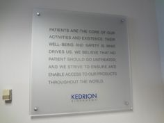 Custom frosted acrylic / frosted plexiglass sign panel with digital die-cut graphics/lettering, mounted with stainless steel standoffs onto wall interior in NYC. We specialize in custom office signs in New York, NY. Visit our website below to contact us for a free consultation! http://www.SignsVisual.com