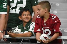 Monday Night Football: Jets vs. Cardinals:     October 17, 2016  -  28-03, Cardinals  -     A New York Jets and Arizona Cardinals fan react prior to the NFL game between the New York Jets and Arizona Cardinals at University of Phoenix Stadium on Oct. 17, 2016 in Glendale, Ariz.