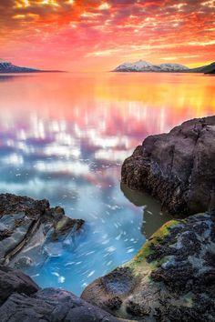 The sun sets behind Mt Kaldbakur in Eyjafjörður, North Iceland by Helga Kvam