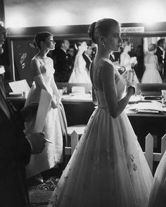 Audrey Hepburn and Grace Kelly waiting backstage at the RKO Pantages Theatre during the 28th Annual Academy Awards, 1956. (Allan Grant—The LIFE Picture Collection/Getty Images) #LIFElegends #tbt