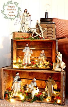 """The Cozy Old """"Farmhouse"""": Rustic Nativity with Crates - I really like this way of displaying the Nativity figures! The lights add a nice touch too, as does a star on top with the angel."""