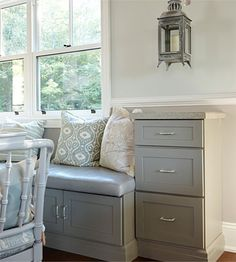 A built in banquette offers extra storage and a cozy place to hang out in the hub of the house. Lowes lower cabinets and in the kitchen color: harbour mist. Upper ones in the kitchen color: divinity.