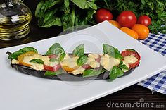 Baked eggplant with tomato cheese and basil