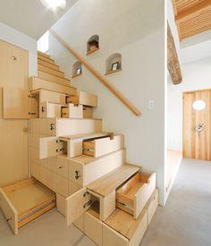 Using traditional Japanese carpenter techniques, architect Kotaro Anzai created a custom-built kaidan dansu or staircase cabinet.