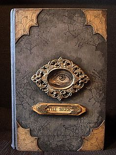 """Original purpose: old book, old frame, bits of cardboard. Up-cycled creation: the """"Seer"""" altered book."""