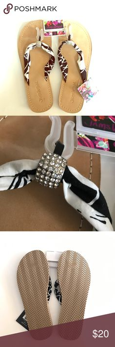 New Jams World Slippers/Flip Flops New with Tag. 100% Authentic Jams World Boardwalk Slippers. Soft black & white fabric thongs with nice bling hardware. Suede with white stitches. jams world Shoes Slippers