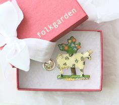 A folkgarden gift-boxed pin inspired by a Staffordshire Cow Figure.
