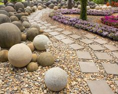 concrete balls nestled in stones make a rock garden type display. 11 Simple Outdoor Living Design Tips To Add Backyard Spark Stone Garden Paths, Garden Stones, Garden Balls, Garden Spheres, Building A Chicken Coop, Concrete Garden, Concrete Slab, Concrete Countertops, Backyard Projects
