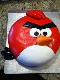 I need to get Kris one of these for his birthday. He LOVES Angry Birds -- Red Angry Bird Cake