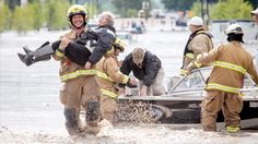 Sometimes we forget that we have heroes right in our backyard - Calgary firefighter rescuing an old woman in High River.  (I'd be okay with being the old woman....just sayin)