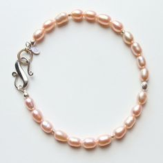 Items similar to Pink pearl bracelet with sterling silver clasp, dainty pink pearl bracelet, June birthstone, rice shaped pearls on Etsy Perfect Gift For Her, Gifts For Her, Pearl Bracelet, Beaded Bracelets, Moon Jewelry, June Birth Stone, Sterling Silver Bracelets, Birthstones, Jewelry Gifts