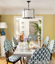 Great paint color (Benjamin Moore Mother Earth) in this dining room. I also like the lights in front of mirrors (there are two). Aspen Iron ceiling light from Circa. Fabricadabra's Cheeky ikat on vintage Windsor chairs. Lindsay Reid design-June 2011 House Beautiful