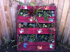 Second project done...old pallet with 3 sets of little girls hands to personalize it.