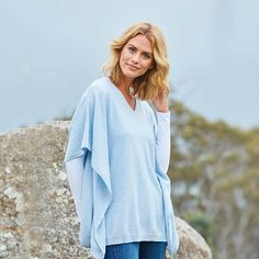 """The most perfect transeasonal piece in the softest baby blue cashmere! The V neck, extended sleeves and flattering drape through the body combine to make this knit look as stunning as it feels. """"Butterfly Shrug"""" by #EverydayCashmere available at birdsnest.com.au #birdsnestonline"""