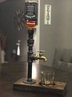 Exclusive handcrafted drink dispenser the perfect rustic addition that your home bar kitchen or man cave is missing product is carefully crafted and handmade to order may choose natural light medium or dark stain bardecorationathome Alcohol Dispenser, Drink Dispenser, Whiskey Dispenser, Deco Cool, Bois Diy, Stainless Steel Pipe, Home Bar Designs, Deco Originale, Man Cave Home Bar