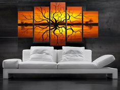 These artistic wall panels adds the right amount of color to this minimalism themed living room.