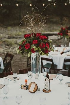 Woodsy red rose centerpiece | Gina & Ryan Photography