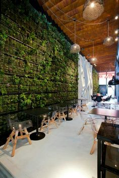 Coffee Shop by 314 architecture studio Vertical garden of herbs on exterior wall