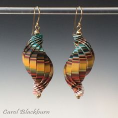 Coloured striped shell earrings by Carol Blackburn, polymer clay.