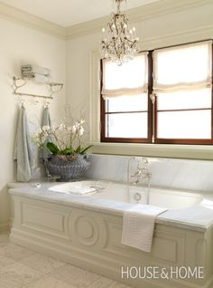 European-Style Bathroom | House & HomeGood use of extra space behind tub - somewhere to hand towels.