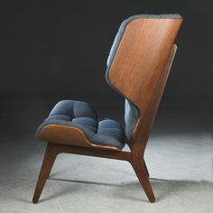 The high back, hugging wings and fluffy upholstery of the 'Mammoth Chair' provides superior comfort and a sense of privacy. This modern wing chair is designed by Rune Krøjgaard & Knut Bendik Humlevik for and it's on auction right now! High Back Chairs, Interior Decorating, Interior Design, Wing Chair, Scandinavian Home, Interior Inspiration, Modern Design, Stool, Dining Chairs