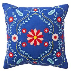 Shop Baja Garden Throw Pillow. With a blue base and multicolored embroidered flowers, this floral throw pillow a traditional Mexico-inspired design.