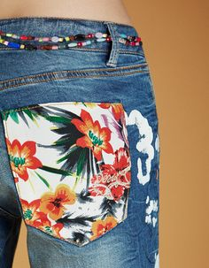 These jeans from Desigual's SS16 Exotic Jeans collection were inspired by Miami, which is represented through tropical flowers and colorful details. The beads and prints combined with cobalt blue denim are a perfect palette for those spring days when the heat is beginning to rise!