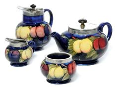 A MOORCROFT WISTERIA TEASET CIRCA 1925 comprising teapot and cover, hot water pot with cover, milk jug and sugar bowl, hammered pewter, pottery, tubelined and glazed impressed marks and blue painted monogram