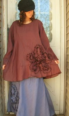 Great purpley brown lightweight linen in a new design, this has a slightly curved empire waistline, with a bias bottom that flounces and