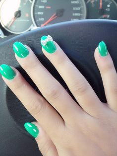 Oval nails with a little bow.<3  Don't normally like oval but these are so cute it might just be the color
