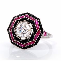 This extraordinary diamond engagement ring is beautifully handcrafted in solid platinum. This lovely ring is centered with 1 genuine round cut diamond approx. 1.25ct, I color, VS2 clarity and accented with some 6 genuine diamonds approx. 0.10 ct, G color, VS clarity, 20 genuine French cut rubies approx. 0.50 ct along with 24 genuine onyx.