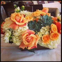 "Centerpiece in a rectangle box. Reflexed ""Cherry Brandy"" roses, ""Macarena""spray roses, white dahlias, gray succulents & white hydrangea."