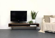 This design is in stock and will be ready to ship in around 3-5 days from order. This is a low version of our classic industrial rustic style TV console, media unit or coffee table. It is made from solid high quality softwood sanded to a beautifully smooth finish. It is stained in a