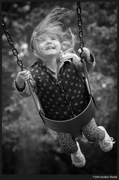 Flying High (by Jordan Steele_ [girl on swing]