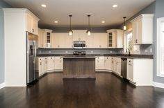 Custom two-tone kitchen with custom built maple cabinets in Modified Riley floor plan by DJK Homes.