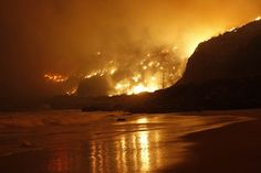 reflection of fire on beach