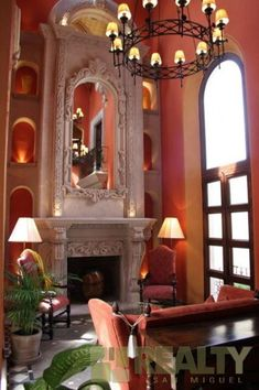 Love the warmth of this room color. Terrific fireplace and alcoves.