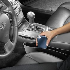The Catch Caddy Seat Pocket Catcher is a useful device to have in your car as it fits snugly between the seat and the console to prevent losing items underneath your car seats. It even features an antimicrobial protective coating.