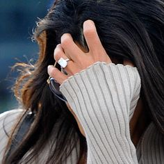George Clooney's fiancée Amal Alamuddin flashes her giant engagement ring in London